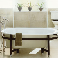 Iron Works Tellieur bath with Sandbar exterior and Black Forest surround